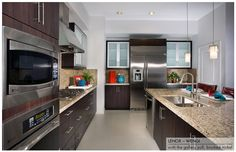 Our Phoenix Area Granite Countertops and PCS European Frameless Kitchen Cabinets Lenox in Wengi See More on our Website Granite Countertops Page http://www.kitchenazcabinets.com/granite-countertops-30-stock-colors
