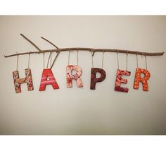 DIY Baby Name Art in Nursery - love the sticks; this would be cute on a door or wall to toddlers room too.