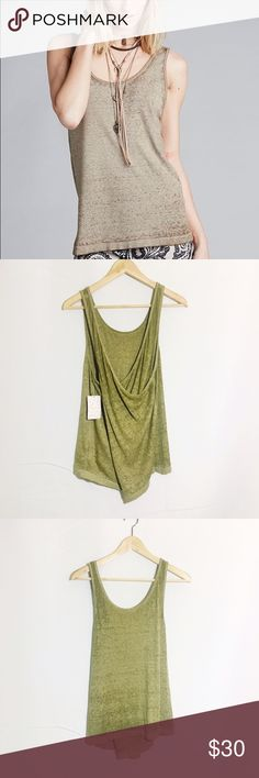 NWT FREE PEOPLE break of dawn cross back tank Super soft we the free tank moss color brand new cross back Free People Tops Tank Tops
