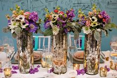 Wildflowers in tall mercury vases by Just Bloomed