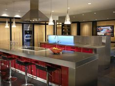 Modern Kitchen  Built-in conveniences are top priority in this high-gloss modern kitchen: a docking station for electronics and a built-in dog-feeding station are just the beginning. Two islands — one with a programmab… more