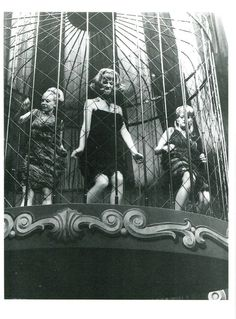 1960s go go dancers in a cage.
