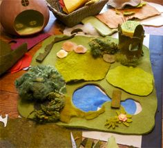 The beginning of a Spring Playmat with pond and tree stump