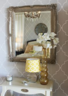 Mirror Wall in Master Bedroom on Stylemindchic Lifestyle.  Quatrefoil wallpaper, mirror, chandelier, vingtage, bedroom, styling