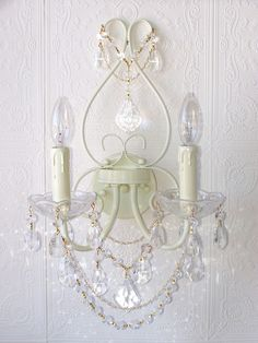 Double-Light Ivory Crystal Wall Sconce  I would love this (or a good looking fake) for the girls' bedroom.....