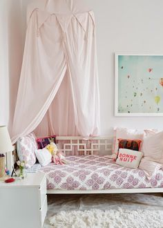 girls-bedroom-NYC-home tour-inspiration-cupofjo-canopy-pink-hot-air-balloon-painting