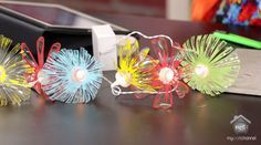 Drowning in disposable water bottles? Upcycle them into string light accents and cute custom beads. How-to video by Lori Allred of Allred Designs.