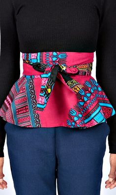 An Ankara print reversible fabric belt in a figure-flattering peplum style.