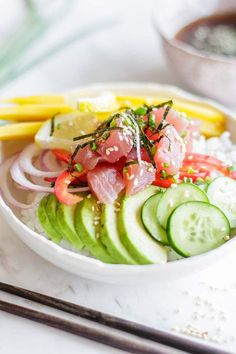 Ahi Poke Bowl / All the flavors of sushi, loaded up in an easier-to-eat bowl. This recipe is #glutenfree and #soyfree using coconut aminos in the sauce.   SUNKISSEDKITCHEN.COM   #pokebowl #poke #ahi #tuna #sushi #Hawaiian