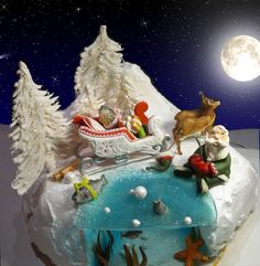 Santa out fishing in the ice - marzipan and gingerbread decorations.
