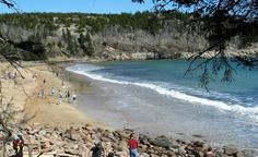Maine's  may be small in relation to other national parks, but it has granite peaks, forest paths and a scenic beach. Acadia National Park is located where the Cadillac Mountains meet the Bay of Fundy.