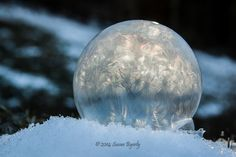 frozen bubble via http://photographyblogger.net/bubbles-in-the-snow-incredible-frozen-pictures-by-susan-byerly/
