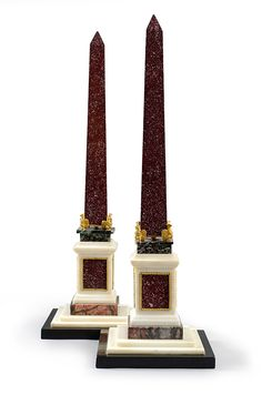 A pair of Egyptian Porphyry Obelisks supported by four Ormolu Eagles ; Design Inspired by the obelisk erected on the Quirinale Square, Rome in 1782 by Pope Pius VI (1775-1799) - Roman work in the taste of the works done by Giuseppe Valadier - H. 60 cm.