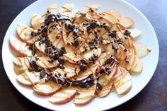 Apple Nachos with peanut butter and chocolate drizzle. Fruit, protein and chocolate makes this a great healthy snack at any time! | trialandeater.com