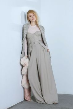 Nellie Partow's wool and cashmere cardigan; Dominic Louis' wool crepe bodice and pants; BP Studio's angora, nylon and wool sweater; Helen Yarmak fox stole. [Photo by George Chinsee]