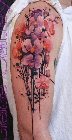 Amazing floral drip inspired sleeve tattoo. The flowers are inked in watercolor style which falls into artistic looking dripping stems below.