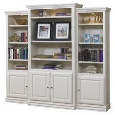 Showcasing crown molding-inspired trim and overhead spotlights, this handcrafted wood bookcase is perfect for displaying leather-bound tomes and treasured tr...