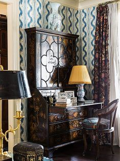 """A secretary desk embellished with chinoiserie motifs hosts a lamp that was once a vase. Silver accents and stacks of books transform this simple """"station"""" into a vignette. - Inside the Atlanta Home of Designer Danielle Rollins Pierre Frey, Home Office, Office Decor, Danielle Rollins, Desk Inspiration, Italian Home, Italian Farmhouse, Atlanta Homes, Atlanta Buckhead"""