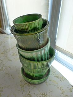 Quote: Vintage McCoy planters to be exact, and in this entry at least, green planters Bauer Pottery, Antique Pottery, Mccoy Pottery Vases, Pottery Clay, Pottery Studio, Vintage Planters, Vintage Vases, Vintage Crockery, Vintage Glassware
