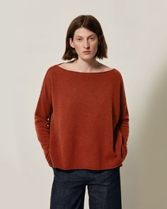 Superfine lambswool. Wide boat-ish neck. Slouchy cut. Dropped shoulders. Exposed seams on armhole and shoulder. Split hem.
