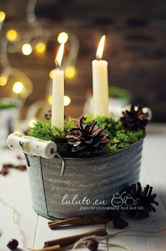 Mini, zinc tub, hand-picked moss, pine cones and simple, white candles.