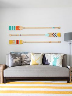 One of my favorite things is adding personal touches to the rooms I give makeovers to. For the colorful camp playroom, there was a long wall that I wanted to fill, but I did not want to overload it wi Coastal Decor, Diy Home Decor, Painted Oars, I Spy Diy, Burner Covers, Camping Crafts, Inspiration Wall, Girl Room, Decoration