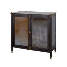 Glass Front Patina Cabinet | dotandbo.com Tough as nails with old-world charm, this cabinet blends gorgeous antiqued metal with weathered glass panels to give you a unique storage piece. Stash your barware in it for a surprising and chic home bar.