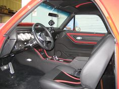This El Camino had the original seats, door panels and center console along with a plain speaker box. We re-upholstered the interior with black leather, black carbon fiber leather and red suede accents on the seats and headliner. Installed new black carpet. And then dressed up the speaker box with matching grey leather. Now the interior looks as good as the exterior on the El Camino.