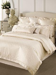 Sumptuous silk bedding.  http://www.beddingworld.co.uk/p/Sheridan_Dorian_Bedding_Set.htm