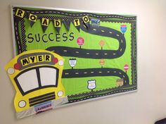 Bulletin board for state achievement test. I created a state license plate with the test name on it (AzMERIT), road signs have test taking strategies, and school bus also includes our school name on it. I am going to add cars with kids names on them as well.