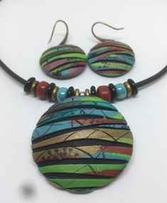 A personal favorite from my Etsy shop https://www.etsy.com/listing/591493948/boho-style-polymer-clay-pendant-set