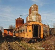 Old grain elevator and railroad cars in Carthage Indiana. <3