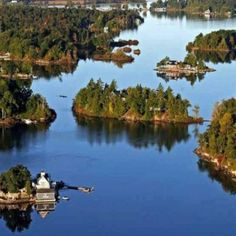 The Thousand Islands are a chain of islands that straddle the US-Canadian border in the Saint Lawrence River as it emerges from the northeast corner of Lake Ontario. Places To Travel, Places To See, Saint Lawrence River, St Lawrence, Michigan, Us Islands, Costa, Thousand Islands, Of Montreal