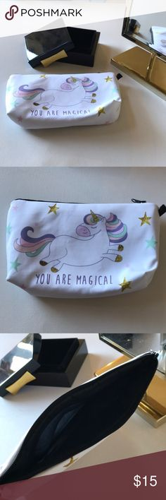 """NWT Magical Unicorn Make-Up Bag 濾 Boutique Listing 濾 Condition: Brand New/NWT/New in Package   Size: 8"""" long 5"""" Tall  Style: White Print Cosmetics Bag with a pastel Unicorn. """"You are Magical"""" printed in purple. black interior. Perfect for make-up, jewelry or school supplies!   *Unicorn Kawaii Babydoll Lolita   New! Bundle & Save with my Other Listings! Boutique Bags Cosmetic Bags & Cases"""