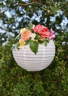 DIY flower paper lanterns. Make these gorgeous paper lanterns with just a few supplies in a few minutes. Perfect for a bridal or baby shower, birthday party, wedding, nursery decor, and more! #weddingdecoration