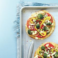 Pita pizza with hummus and mint recipe - A Middle-Eastern inspired pizza that's topped with healthy veggies and protein-rich hummus. Chatelaine.com