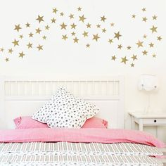 55 gold or silver metallic multi sized five point star wall decals. Just peel and stick these stars which can scattered or shaped in a wave or any way you please. Gold and silver metallic are such lov