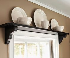 shelf over window - love this! I love that the shelf is black with a white window sash