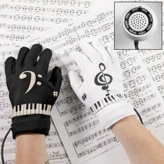 "Electric Piano Gloves by ComputerGear. $39.99. Features 8 different instrument sounds, 8 different background rhythms, external speaker with volume and tempo controls, 6 demo songs and instructions. Requires 4AAA batteries, not included. ComputerGear exclusive. You'll have a musical touch when you put these gloves on and ""play piano keys"" -- each finger tip sounds a different musical note. Turn any surface into a piano with Electric Piano Gloves. Turn any surface i..."