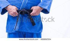Close up of judo judo-gi whit belt isolated on white background
