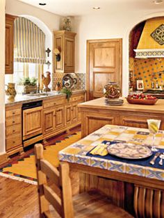 French Country Kitchen Blue And Yellow country kitchen with hickory - tequila engineered hardwood plank