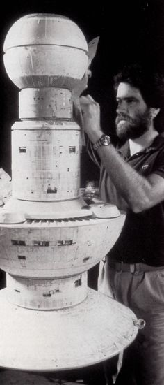 """Building the Space Dock for """"Star Trek: The Search for Spock."""" Instead of building a model and then stringing hundreds of fiber optic lights, they built this model with translucent plastic that was lit internally. Then they painted the """"skin"""" and scratched off where they wanted light to come through."""