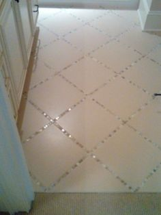 """Lay a thin strip of """"backsplash"""" tile in between the large tiles, instead of just using grout. *simple but huge impact! by patsy"""