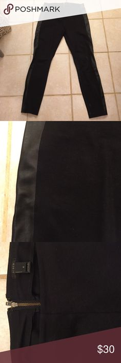 Black skinny crops J. Crew black skinny crops with leather detail. Stretchy and comfortable, fit to body. Very gently used, however attempted to iron and fabric reacted towards bottom of left leg. See photo 4. Not very noticeable. Discounted price to reflect. Dry Clean only. J. Crew Pants Ankle & Cropped