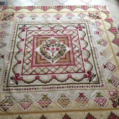 Peggie Wormington's version of Ruffled Roses designed by Sue Garman.  Quilted by  Pamela Joy Spencer Dransfeldt.  Patterns available at www.quakertownquilts.com.