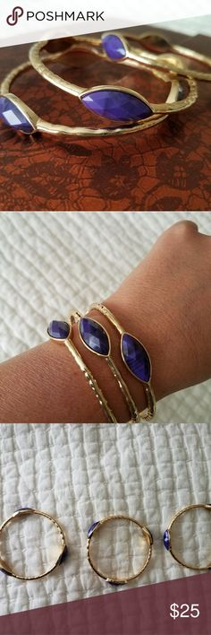 Stackable Gold-tone Bangles w/ Purple Accents Gorgeous!  Solid, heavy bangles in a gold tone, w/ acrylic purple accent stones. Approx. 3 in in diameter. Jewelry Bracelets