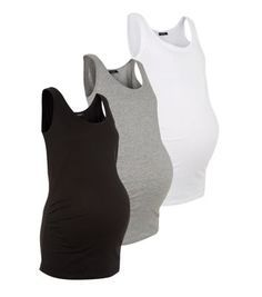 """Maternity. Stock up on summer time basics with this 3 pack vest set. Pair with jeans or leggings.- 3 vests included- Bump accommodating fit- Soft cotton blend- Gathered sides- Longline design- Scoop neck- Model is 5'8""""/176cm and wears UK 10/EU 38/US 6"""