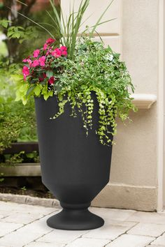 The 23-in tall Vibrato urn has a modern spin on a classic silhouette that coordinates with your contemporary front door décor scheme! Dress up your patio, deck, balcony or outdoor living space with this modern urn, to complement transitional or contemporary patio furniture. Ideal for all plant arrangements in all four seasons outdoors, Vibrato can also be used indoors! Simply ensure that the removable drain plug is in place to prevent leakage during watering. Contemporary Front Doors, Contemporary Patio, All Plants, Water Plants, Urn Planters, Used Tires, Outdoor Material, Recycled Rubber, Self Watering