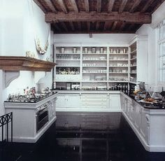 I love the open storage in the space, perfect for a foodie! The exposed beams are also fantastic.