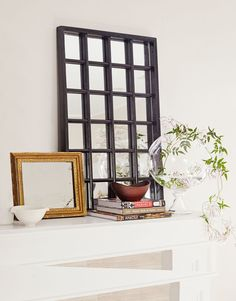 Price: $25 Supplies: $54 Henderson loved the bold geometrics of this Japanese window frame. Painted black and backed with a mirror, it anchors the mantel Total cost: $79
